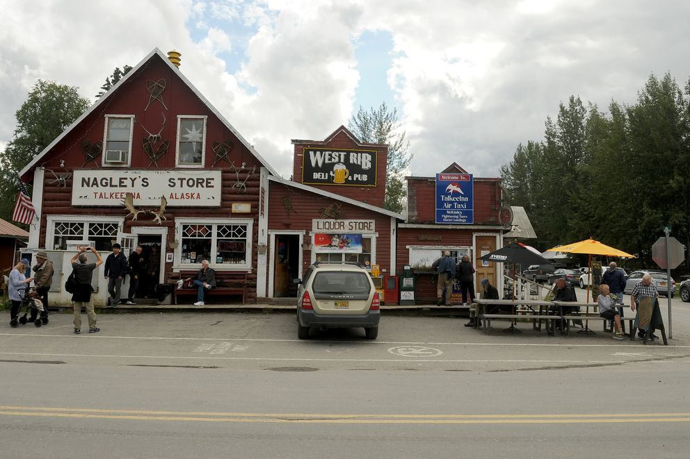 Tourists wander the main street of Talkeetna, AK on Wednesday, August 10, 2016. Talkeetna has come to be a very popular summer destination for tourists, drawing hundreds of people to the small town that is the jumping off spot for most Denali climbers. (Bob Hallinen / Alaska Dispatch News)
