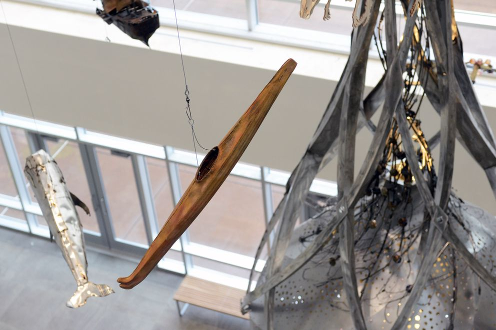 "A kayak by local artist Andrew Abyo is incorporated into the ""Portal of Perception"" hanging sculpture produced in Portland for the Loussac Library. The library reopened Wednesday after a two-week hiatus. (Erik Hill / Alaska Dispatch News)"