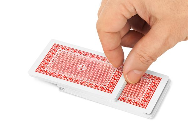 Hand drawing a playing card from a deck of cards (Getty Images)