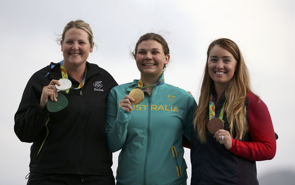 From left to right, Natalie Rooney of New Zealand, Catherine Skinner of Australia and Corey Cogdell-Unrein of Eagle River pose with their medals. (Edgard Garrido / Reuters)