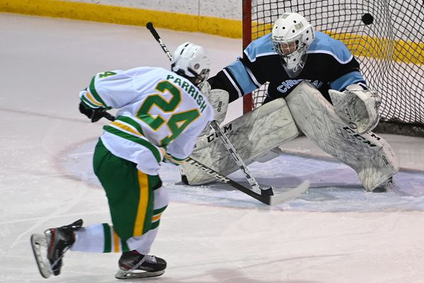 Service High's Zackery Parrish scored the first goal of the game as he slipped the puck past Chugiak goaltender Daegan Love during the Cougars' 7-4 victory over the Mustangs on the opening day of the CIC hockey tournament at Ben Boeke Ice Arena on May, 4, 2021. (Bill Roth / ADN)