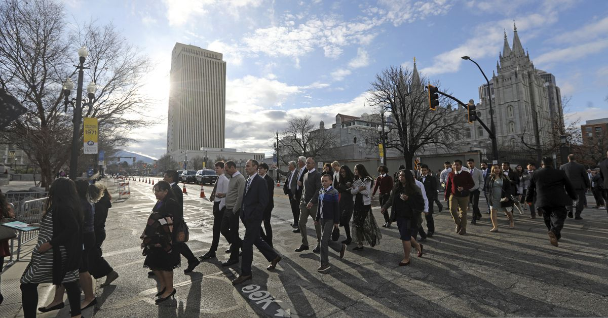 People arrive for The Church of Jesus Christ of Latter-day Saints' two-day conference Saturday, April 6, 2019, in Salt Lake City. (AP Photo/Rick Bowmer)