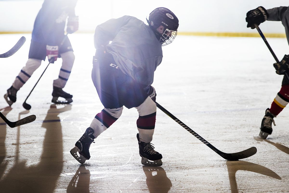 A member of the Manchester Flames under-16 hockey team takes part in practice on Nov. 24. Two weeks earlier, seven governors in the Northeast banded together to ban all interstate youth hockey until at least the end of the year. (Photo by Adam Glanzman for The Washington Post)