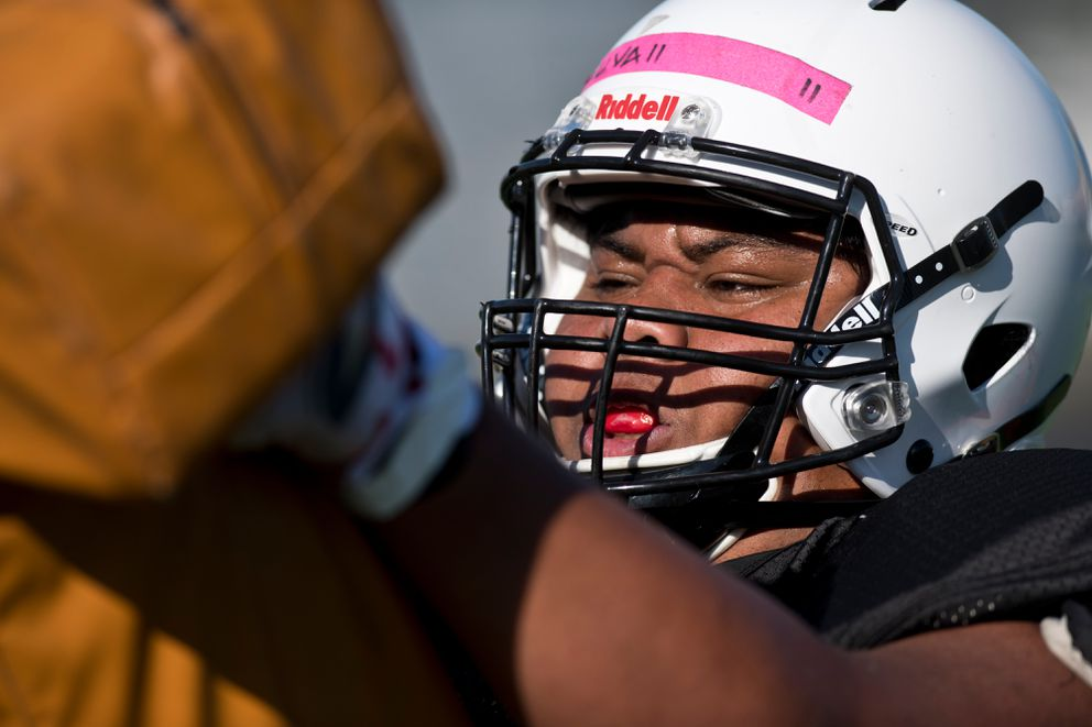West Eagles lineman Tea Seuvaai hits a sled pad during practice Thursday. (Marc Lester / ADN)