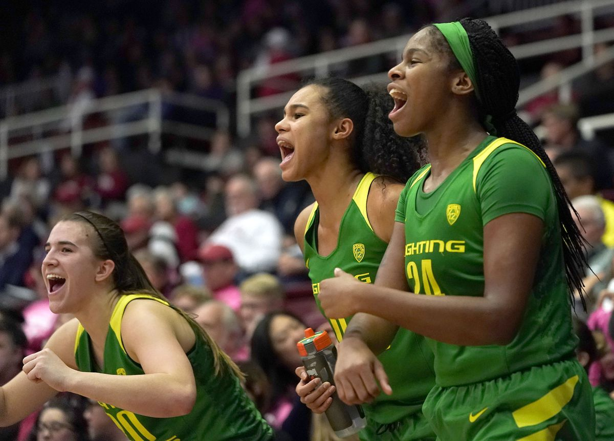 Oregon senior Ruthy Hebard of Fairbanks, right, was named to the AP All-America Division I women's basketball first-team on Thursday. Tony Avelar / Associated Press)