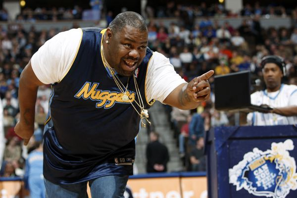 """Biz Markie performs for fans during halftime of the Denver Nuggets' 105-99 victory over the Phoenix Suns in an NBA basketball game in Denver on Dec. 12, 2009. The hip-hop staple known for his beatboxing prowess, turntable mastery and the 1989 classic """"Just a Friend,"""" has died. He was 57. Markie's representative, Jenni Izumi, said in a statement that the rapper-DJ died peacefully Friday, July 16, 2021, with his wife by his side. No cause of death was released. (AP Photo/David Zalubowski)"""