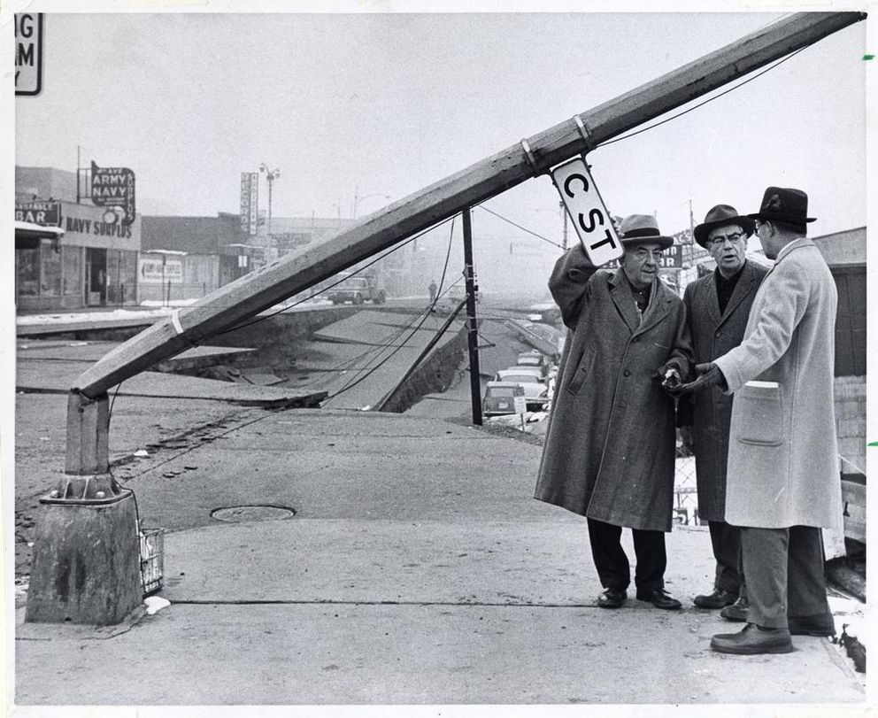 Alaska U.S. Sens. Ernest Gruening and Bob Bartlett and Office of Emergency Planning Director Edward McDermott confer at C Street and Fourth Avenue in downtown Anchorage after the 1964 Good Friday Alaska earthquake. (Anchorage Times / ADN archive)