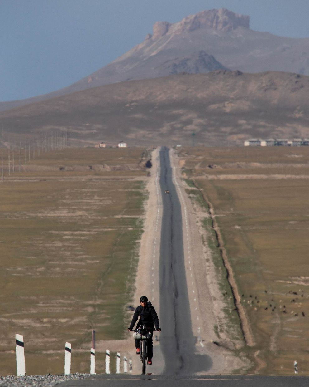 Lael Wilcox rides on the Chinese Highway on day three of the Silk Road Race in Kyrgyzstan. (Courtesy Rugile Kaladyte)