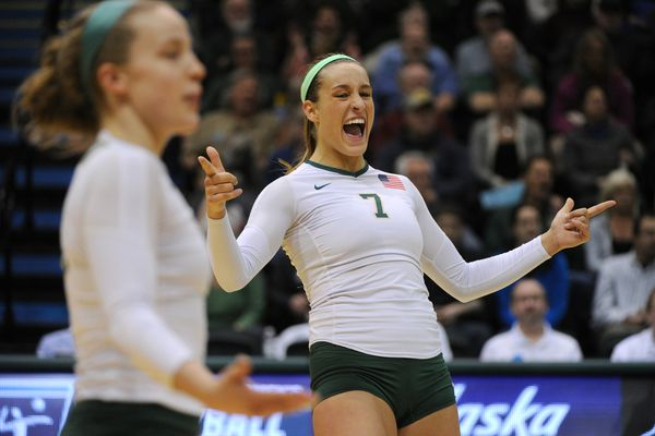 UAA sophomore Leah Swiss, right, celebrates a point during the Seawolves' 3-0 victory over the Chico State Wildcats in the first-round of the NCAA Division II West Regional Volleyball Championships at the Alaska Airlines Center on Thursday, Dec. 1, 2016. Senior Morgan Hooe is at left. (Bill Roth / Alaska Dispatch News)