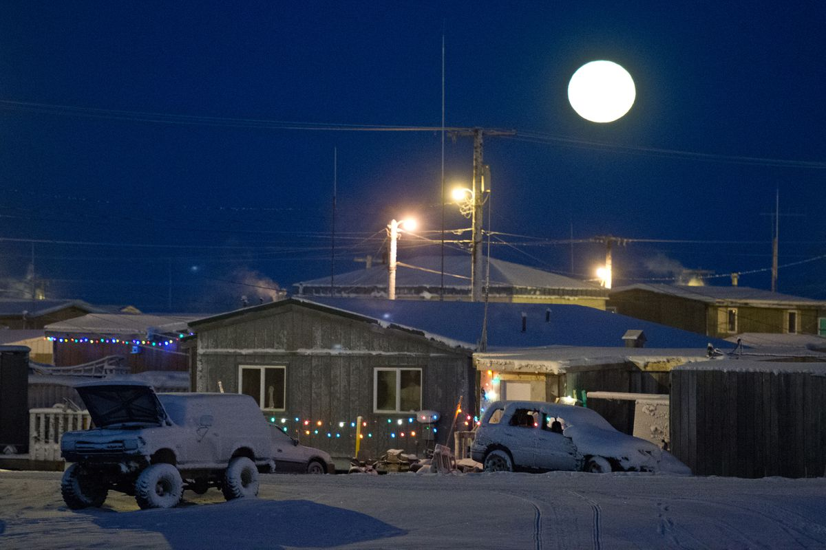A full moon adds to the residential lights in Utqiagvik. Strings of lights and Christmas decorations adorn many homes and streets in Utqiagvik, adding a sparkle to the darkest time of year in this Arctic community. (Marc Lester / ADN file)