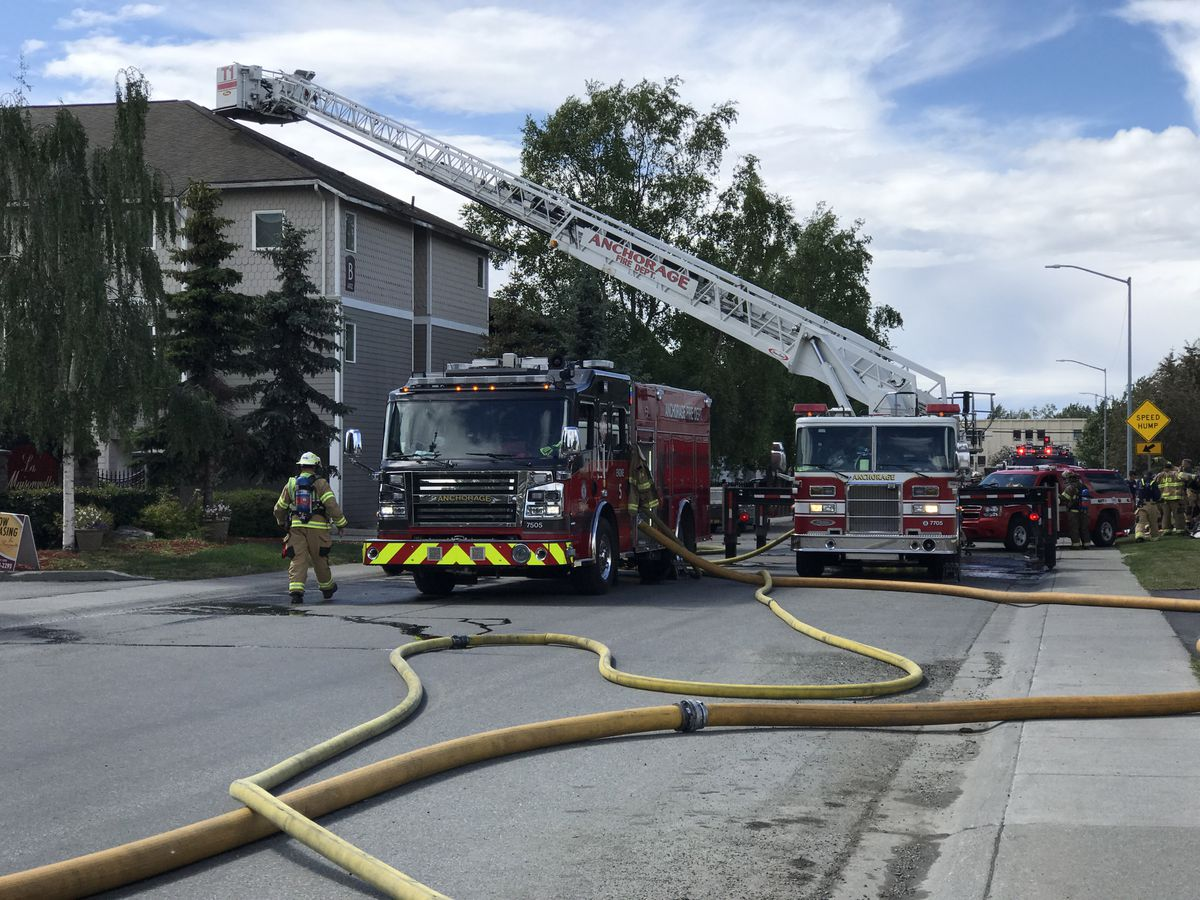 Anchorage firefighters work on a fire at the La Maisonnette Apartment Homes on West 26th Ave., June 23, 2020 (Bill Roth / ADN)