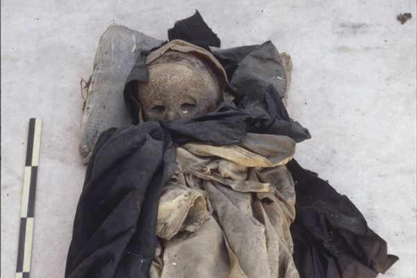 An undated handout photo of the mummified remains of a 16th-century child buried in the Basilica of Saint Domenico Maggiore in Naples, Italy. (Gino Fornaciari/University of Pisa via The New York Times)