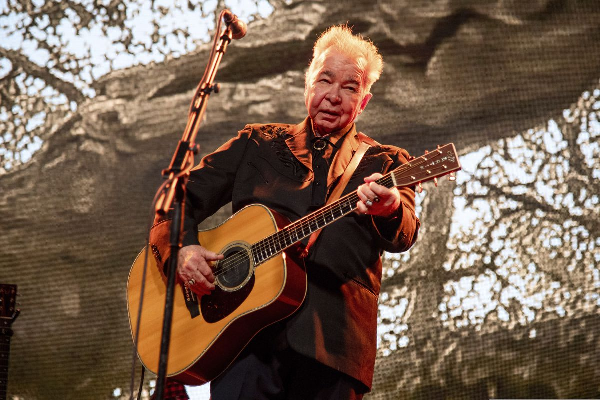 "FILE - This June 15, 2019 file photo shows John Prine performing at the Bonnaroo Music and Arts Festival in Manchester, Tenn. The family of John Prine says the singer-songwriter is critically ill and has been placed on a ventilator while being treated for COVID-19-type symptoms. A message posted on Prine's Twitter page Sunday, March 29, 2020 said the ""Angel from Montgomery"" singer has been hospitalized since Thursday and his condition worsened on Saturday. (Photo by Amy Harris/Invision/AP, File)"