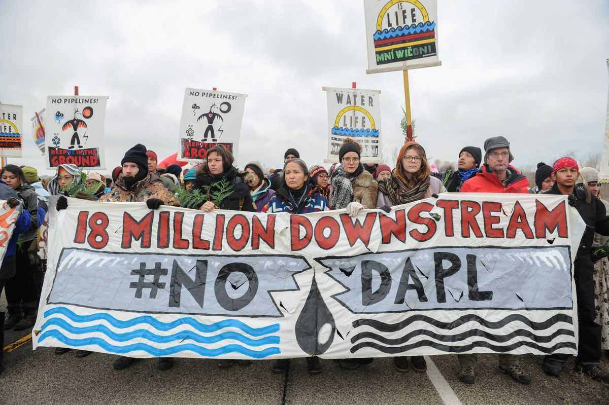 Protesters block highway 1806 in Mandan during a protest against plans to pass the Dakota Access pipeline near the Standing Rock Indian Reservation, North Dakotaon Nov. 23, 2016. (REUTERS/Stephanie Keith)