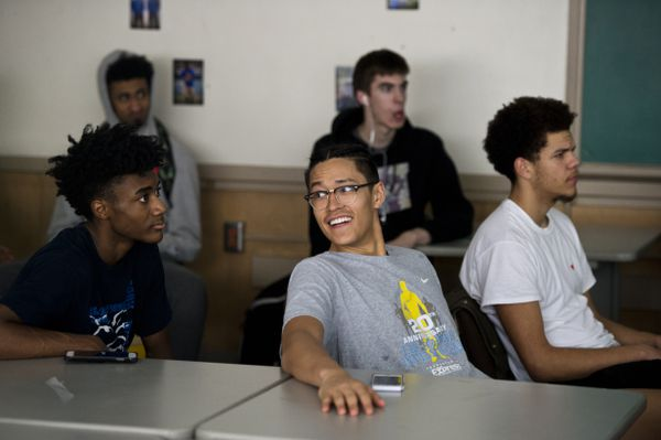 Kamaka Hepa watches game footage with his Jefferson High teammates on Feb. 15, 2018. Jefferson's varsity boys basketball team has won the state championship five of the last 10 years, including last year with Hepa. (Marc Lester / ADN)