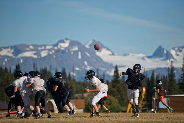 Quarterback Azary Reutov passes during Voznesenka's football practice on Thursday, September 1, 2016. Because the team has only 16 players, there aren't able to practice full 11-on-11 football plays. (Marc Lester / Alaska Dispatch News)
