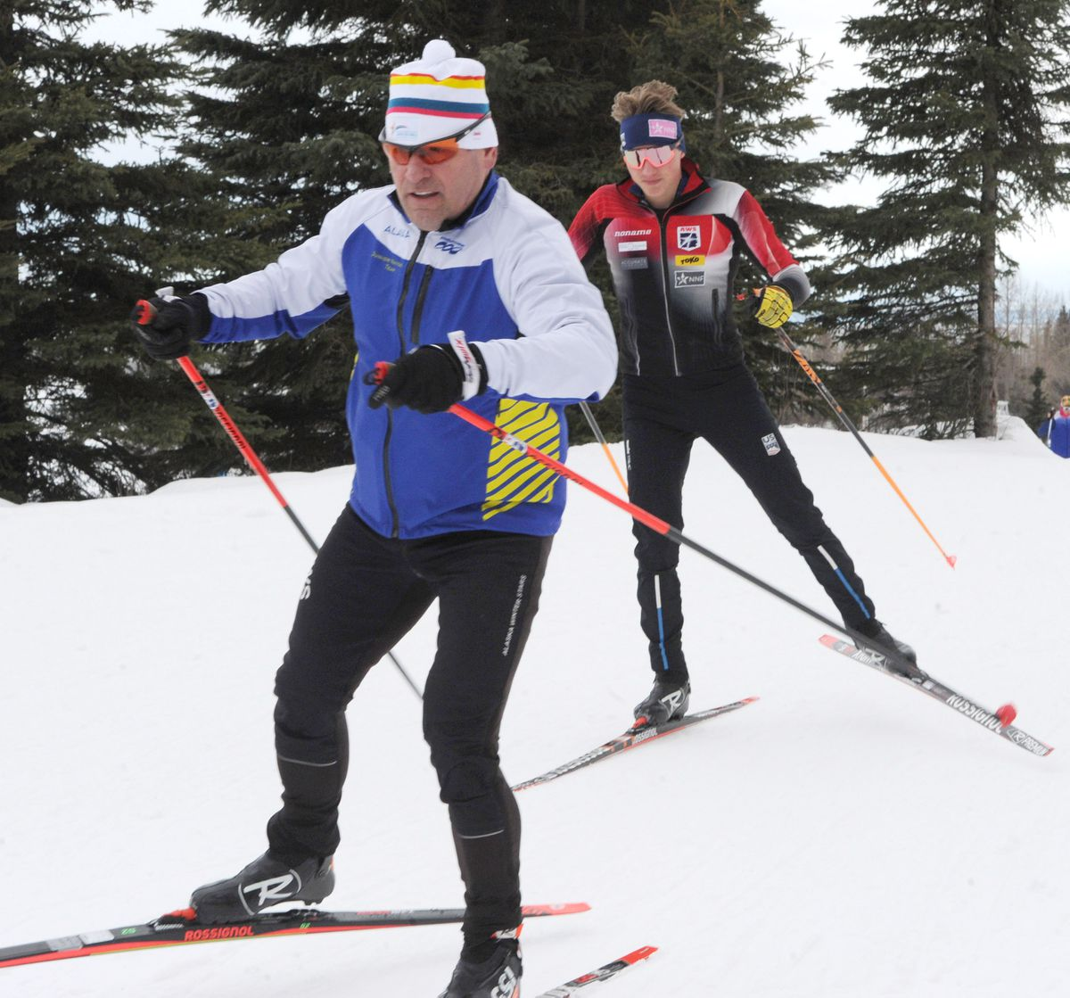 Team Alaska coach Jan Buron, left, and Gus Schumacher test skis at Kincaid Park on March 10 in preparation for the upcoming Junior National nordic championships. (Bill Roth / ADN)