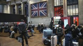 Trucks gridlocked, travelers stranded as Britain hit with new travel bans over coronavirus mutation