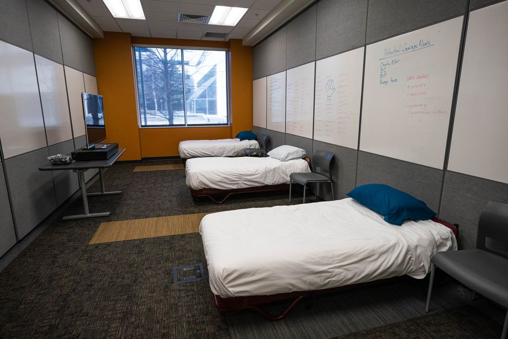 Beds are set up in a conference room at Covenant House, a shelter for homeless, runaway and at-risk youth, on Tuesday, March 31, 2020 in Anchorage. The shelter is converting conference rooms and offices into temporary shelter space, preparing for an influx of youth due to the coronavirus pandemic. (Loren Holmes / ADN)