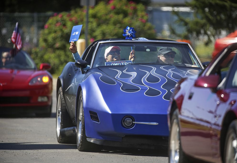 Members of the Anchorage Corvette Association drive in a parade to celebrate seniors living at Chugach View and Chugach Manor. (Emily Mesner / ADN)