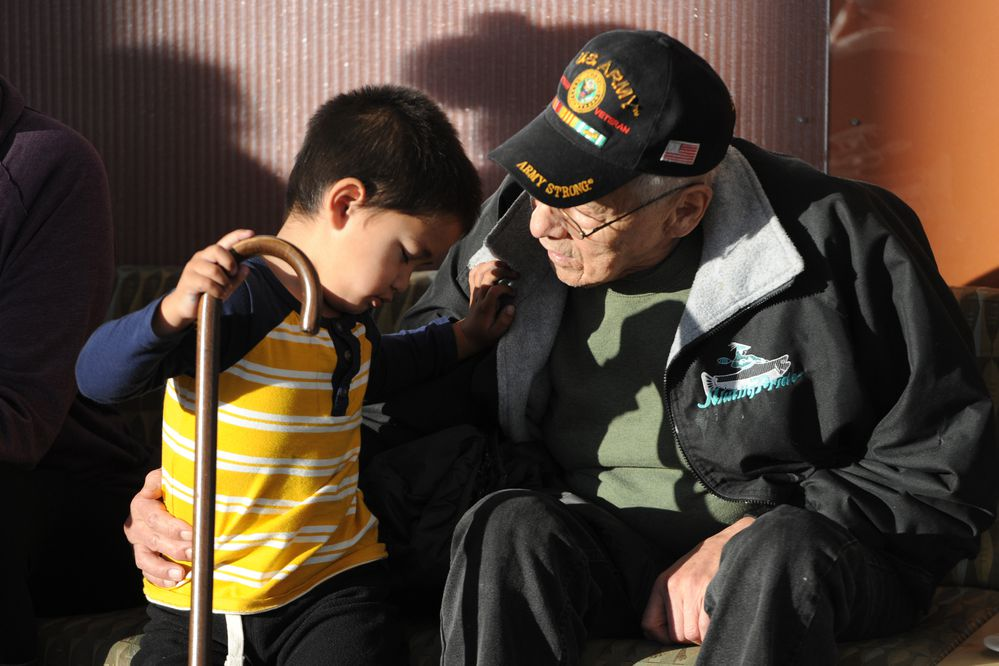 Leonte Vlasoff, 3, and his grandfather Robert Vlasoff of Tatitlek share a moment during the First Alaskans Institute 34th annual Elders and Youth Conference at the Dena'ina Center on Tuesday, Oct. 17, 2017. The three-day conference began on Monday with the theme Part Land, Part Water - Always Native. (Bill Roth / Alaska Dispatch News)