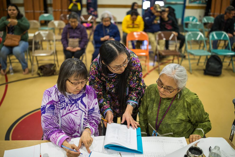 Statewide Yup'ik Spelling Bee for Beginners judges Rebecca Atchak, left, Freda Dan, and Lorina Warren go over results after the first round of the competition on Saturday, April 13, 2019, at College Gate Elementary School. (Loren Holmes / ADN)