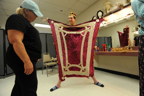 Jonathan Jacob stretches out during costume fitting for the upcoming musical