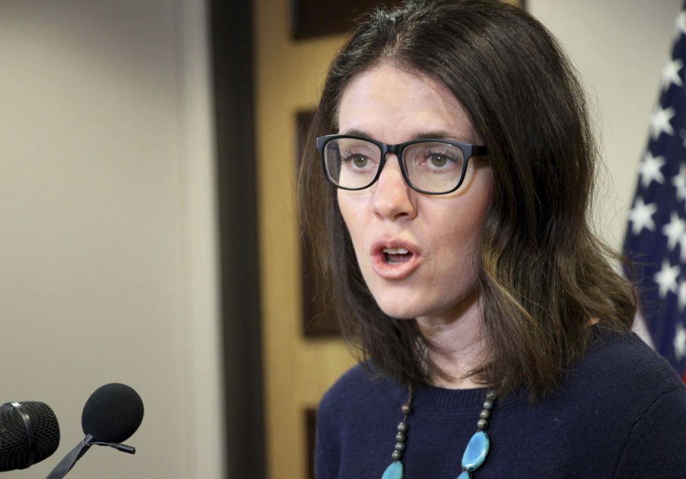 Dr. Anne Zink, the chief medical officer for the state of Alaska, addresses reporters at a news conference Monday, March 9, 2020, in Anchorage. (AP Photo/Mark Thiessen)