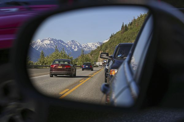 Vehicles traveling northbound from the Kenai Peninsula are at a standstill on the Seward Highway along Turnagain Arm on Sunday, June 13, 2021. (Emily Mesner / ADN)