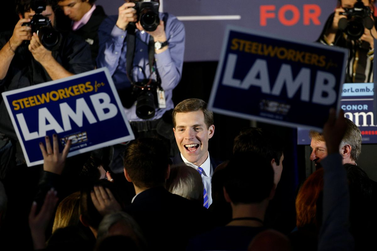 Democratic congressional candidate Conor Lamb is greeted by supporters during his election night rally in Pennsylvania's 18th U.S. Congressional district special election against Republican candidate and State Rep. Rick Saccone, in Canonsburg, Pennsylvania, March 13, 2018. REUTERS/Brendan McDermid