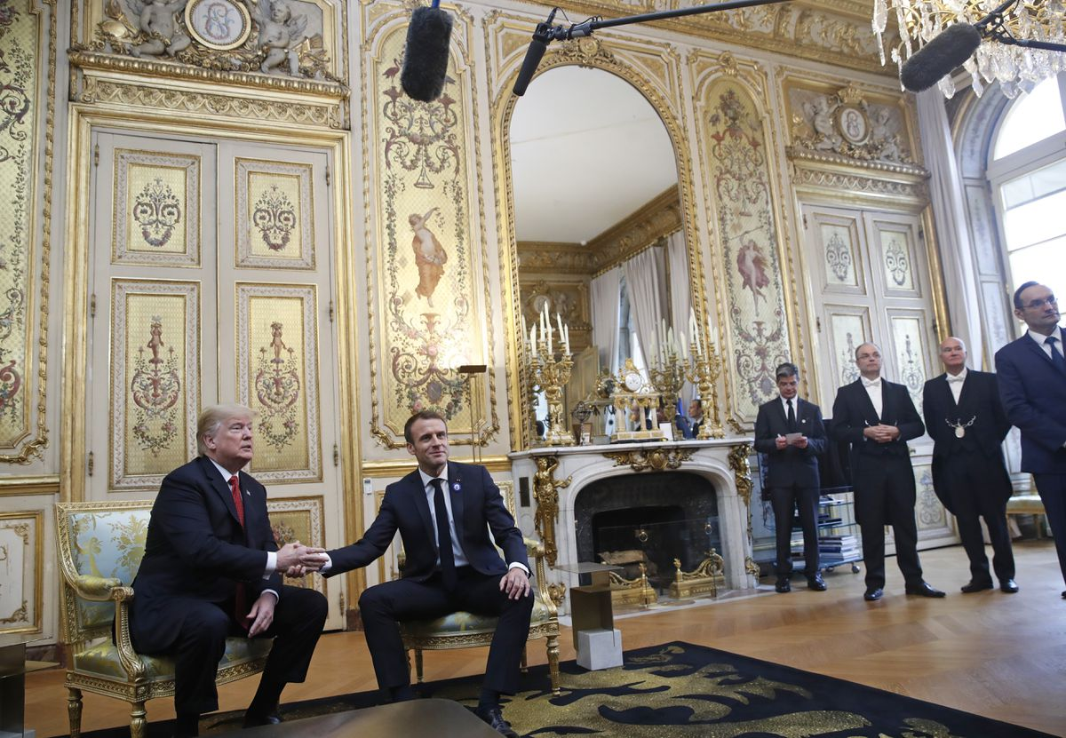 President Donald Trump shakes hands with French President Emmanuel Macron inside the Elysee Palace in Paris Saturday Nov. 10, 2018. Trump is joining other world leaders at centennial commemorations in Paris this weekend to mark the end of World War I. (AP Photo/Jacquelyn Martin)