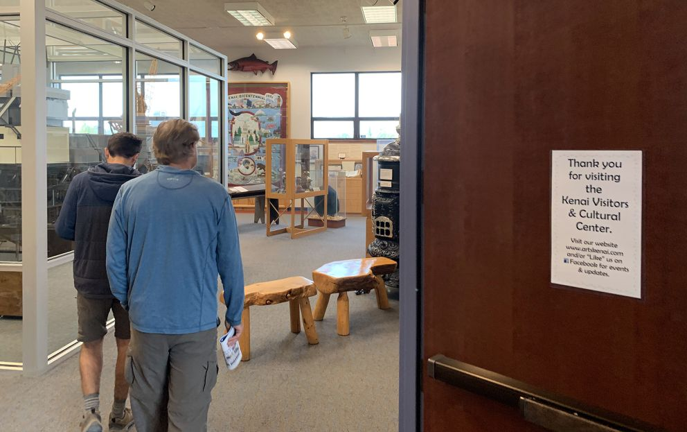 Two men visit the museum inside the Kenai Visitors and Cultural Center on Wednesday, July 10, 2019. (Matt Tunseth / ADN)