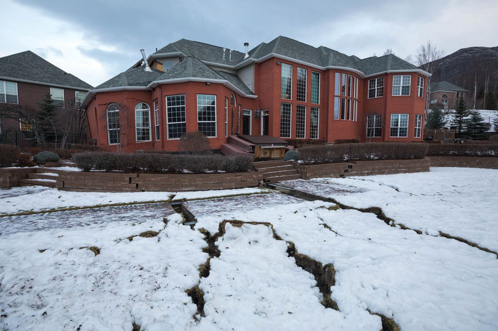 A home in Eagle River is badly damaged Saturday morning, Dec. 1, 2018. The house, which was partly built on fill, suffered severe problems during a strong earthquake that shook southcentral Alaska on Friday. (Loren Holmes / ADN)