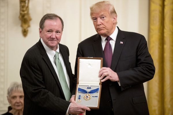 Jack Soden, President and CEO of Elvis Presley Enterprises, accepts the Medal of Freedom on behalf of the Presley family from President Donald Trump during a ceremony in the East Room of the White House in Washington, Friday, Nov. 16, 2018. (AP Photo/Andrew Harnik)