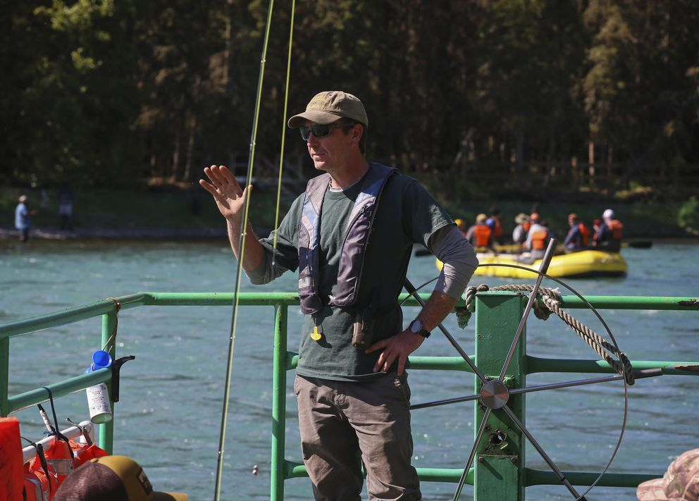Jordan Laumbattus, captain of the Russian River Ferry, waves to a passing vessel. (Emily Mesner / ADN)