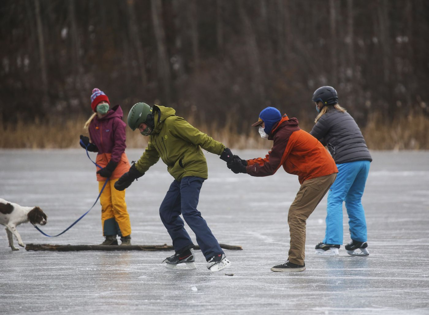 Matt Unterberger's seventh and eighth grade Movement Class from Anchorage Waldorf School ice skate on Cheney Lake in Anchorage on Nov. 5, 2020. (Emily Mesner / ADN)
