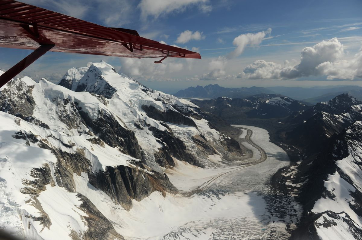 Backside Glacier with Ruth Gorge peaks pass by under the wing as Talkeetna Air Taxi pilot Kris Peterson flies a beaver airplane on a flightseeing tour of Mount McKinley and the peaks and glaciers on the south side of the mountain. Talkeetna Air Taxi flies daily tours of the mountain in Denali National Park. (Bob Hallinen / ADN archive)
