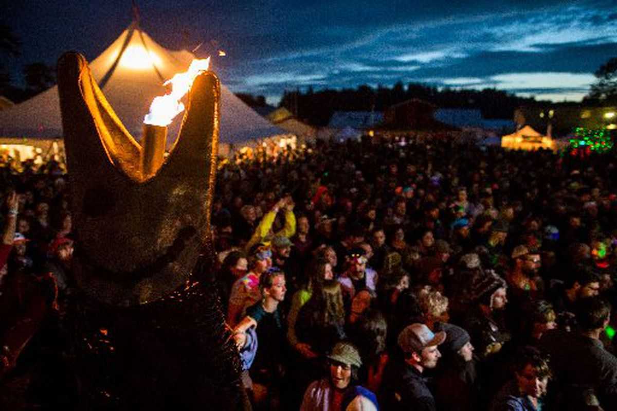 A salmon-themed torch lights the main stage during a set by the Latin-influenced dance band Ozomatli at Salmonstock (now Salmonfest) in Ninilchik in August 2014. (Loren Holmes/ADN archive)