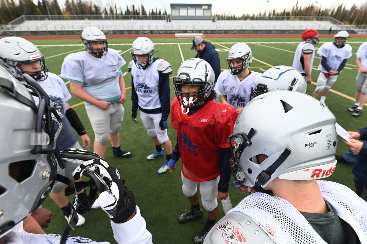 Eagle River players huddle during football practice on Tuesday, Sept. 29, 2020. The team's season ended this week when it was placed on quarantine. (Bill Roth / ADN)