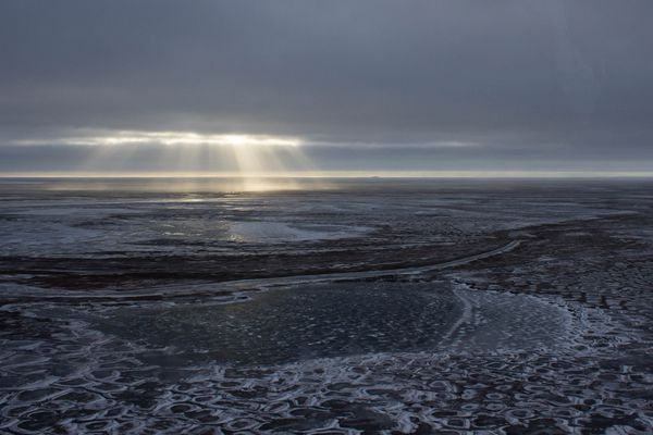 Rays of sunlight crack through the fall clouds hitting the tundra near Prudhoe Bay, Alaska on October 10, 2015. (Asaf Shalev / Alaska Dispatch News)