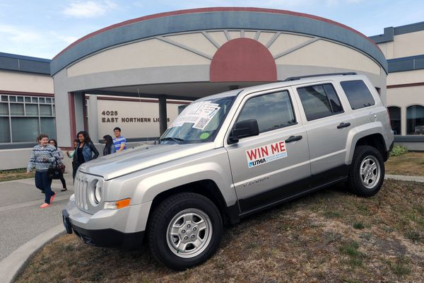 OPINION: First rule of school, as in so much else in life: You have to show up. Pictured: Students check out a Jeep Patriot offered as a perfect attendance incentive prize during registration at East High in August 2013.