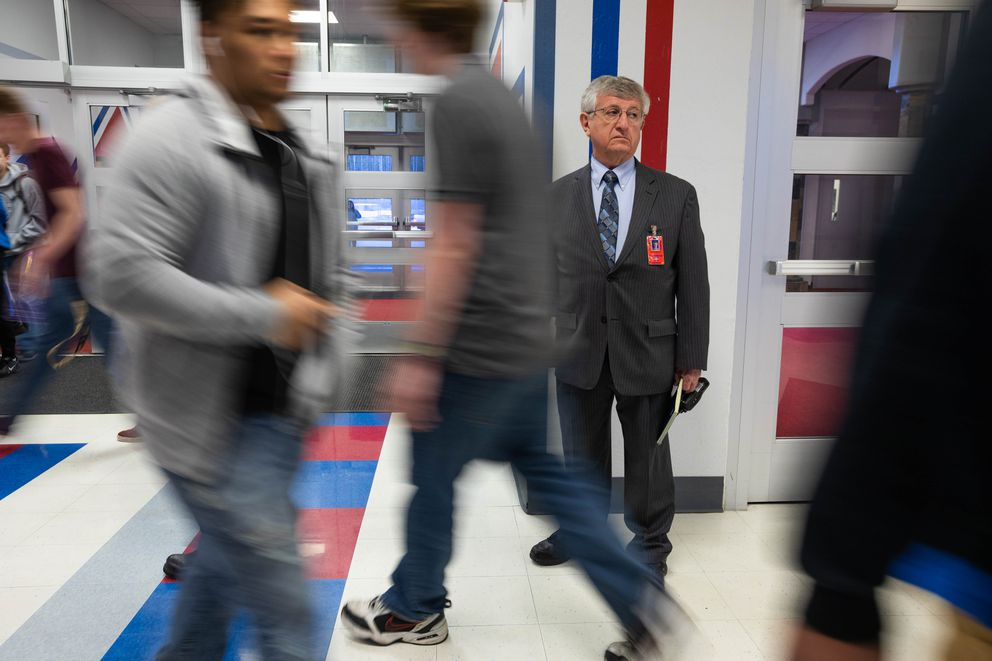 East High principal Sam Spinella monitors an entrance before the start of classes. (Loren Holmes / ADN)
