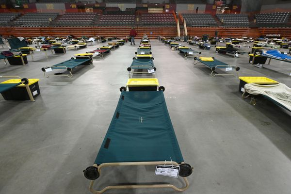 Cots provides social distancing for 240 clients at the emergency shelter for men inside the Sullivan Arena during the COVID-19 pandemic on Wednesday, April 29, 2020. (Bill Roth / ADN)