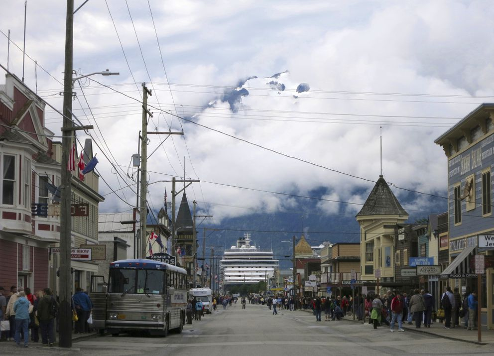 FILE - This July 29, 2014, file photo, shows a cruise ship docked in Skagway, Alaska, as passengers tour the town. (AP Photo/Kathy Matheson, File)