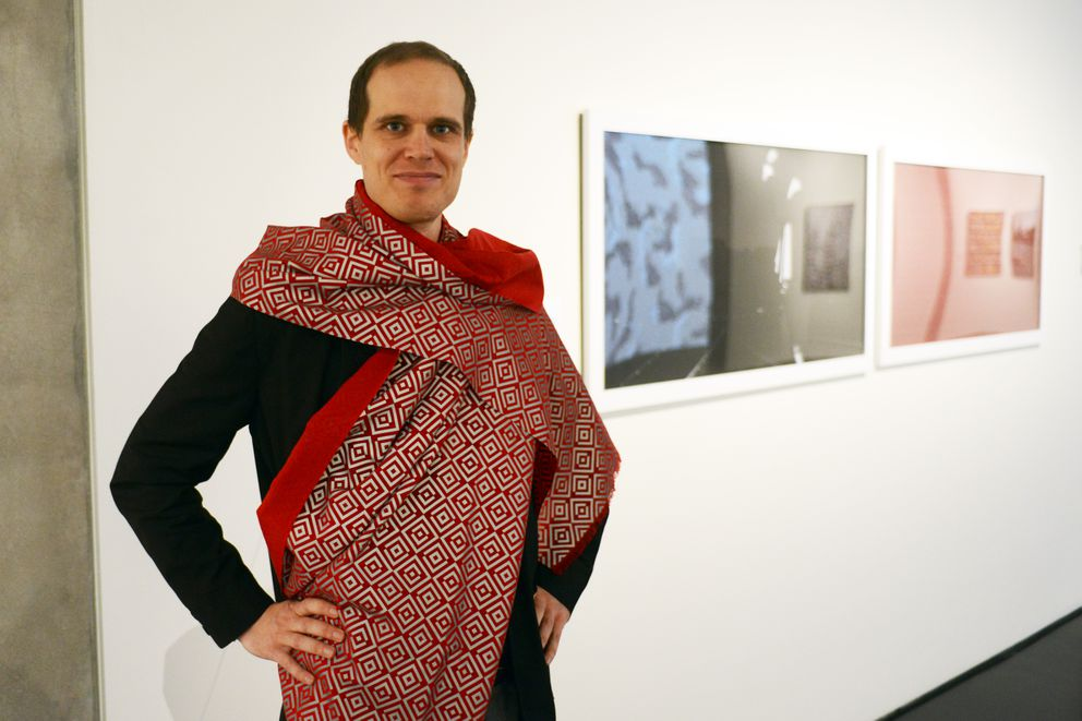 "Thomas Gokey displays a ""cloaking scarf"" while photographed without flash. (Erik Hill / Alaska Dispatch News)"