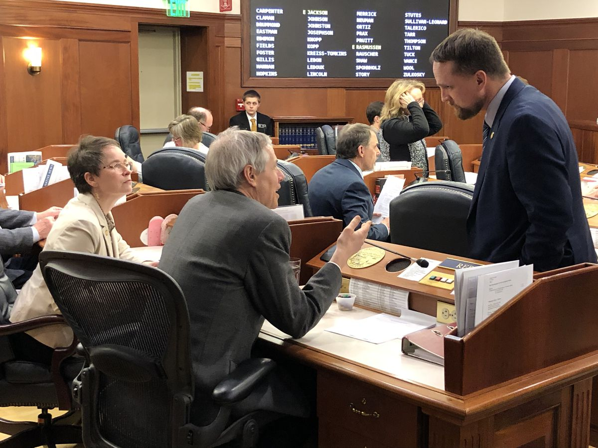 At right, Rep. Ben Carpenter, R-Nikiski, talks to Rep. Sarah Vance, R-Homer, and Rep. Matt Claman, D-Anchorage, during a break Wednesday, March 18, 2020 on the floor of the Alaska House of Representatives. (James Brooks / ADN)