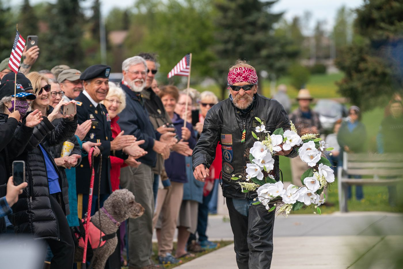 State Rep. Laddie Shaw, R-Anchorage, places a wreath at the Anchorage Veterans Memorial on Delaney Park Strip on Monday, May 25, 2020 during a Memorial Day observance. (Loren Holmes / ADN)