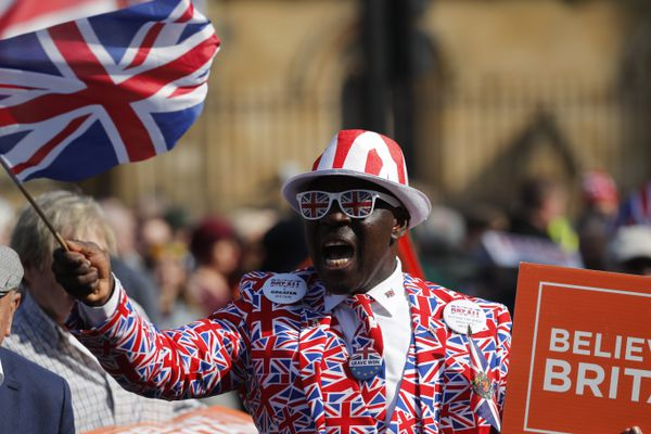 A Brexit supporter waves a Union Jack at Parliament Square in Westminster, London, Friday, March 29, 2019. Pro-Brexit demonstrators were gathering in central London on the day that Britain was originally scheduled to leave the European Union. British lawmakers will vote Friday on what Prime Minister Theresa May's government described as the