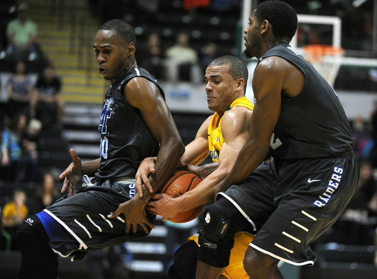 Diante Mitchell of UAA (center) battles for the ball with a pair of Middle Tennessee players at last year's Great Alaska Shootout. Mitchell is one of topplayers who return this season for UAA, which is ranked No. 3 in a national preseason poll.(Bob Hallinen / Alaska Dispatch News)