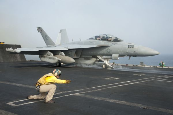 An EA-18G Growler is set to launch from the flight deck of the aircraft carrier Harry S. Truman in 2013. (Emily M. Blair/U.S. Navy)